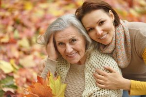 happy Alzheimer's senior mother and adult daughter