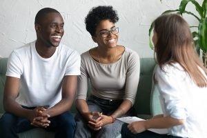happy siblings talking with senior mediator