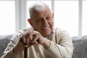 happy senior man with disability at home
